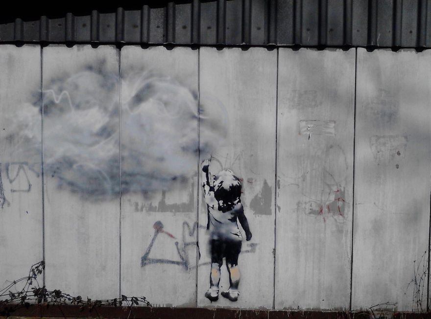 Le migliori opere della street art sui temi sociali foto for Migliori planimetrie della cabina di log